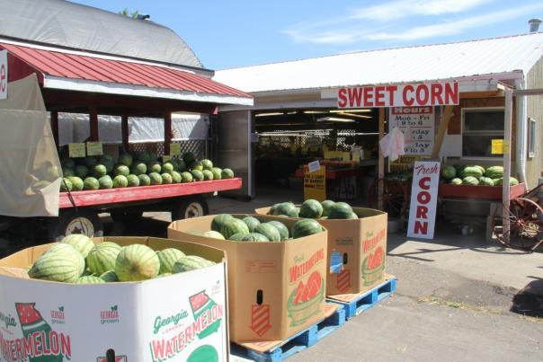 Locally grown watermelons and sweet corn for sale at a farm market in Genesee County, Michigan.