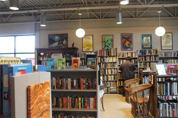 A customer looks at book at Totem Books in Flint, Michigan.
