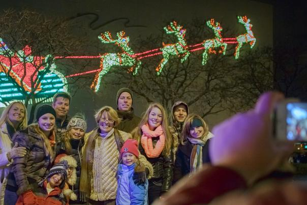Family posing for a picture at Night of Lights in Downtown Fort Wayne