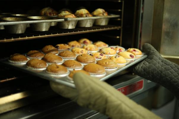 Muffins coming out of the oven - Unsplash Stock Photo