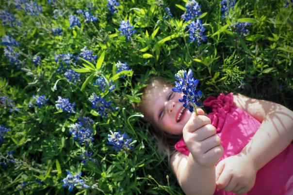 Field of Flowers with Kid