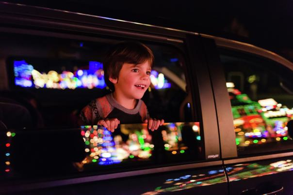 Child viewing light spectacular from car