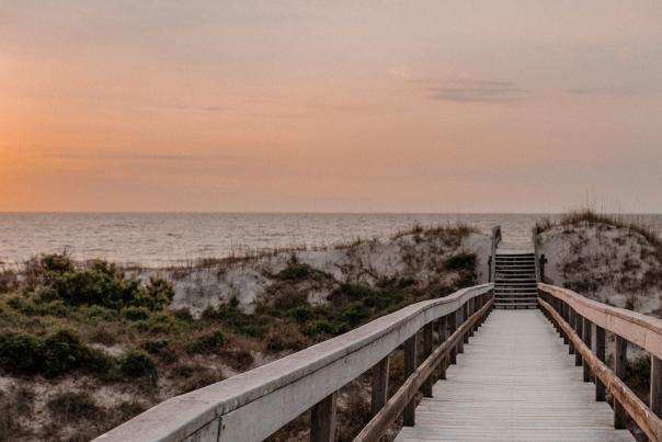 The sun rises above the Atlantic Ocean on Jekyll Island's South Dunes Beach