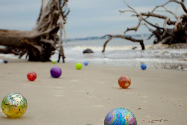Handmade glass floats are hidden all around Jekyll Island each January and February as part of Island Treasures