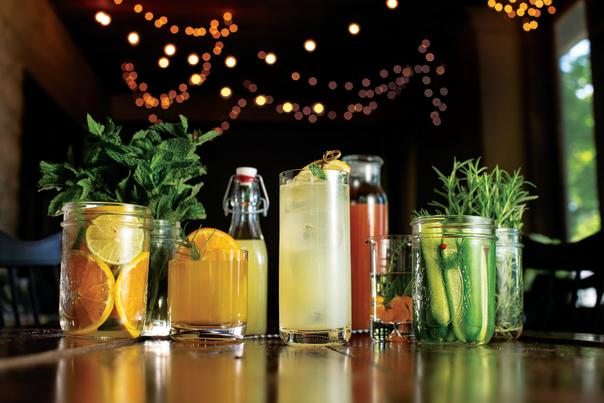 String lights in the background of colorful craft drinks.