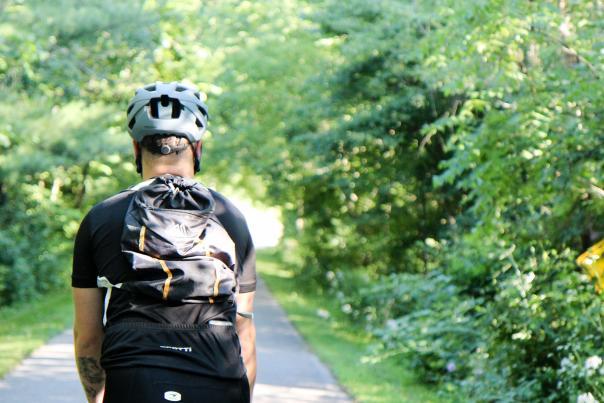 Main with backpack biking on White Pine Trail
