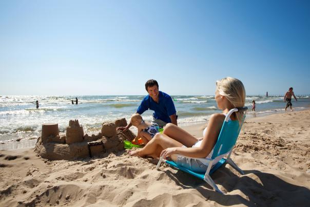 Happy Family Building a Sandcastle on a Beach near Grand Rapids