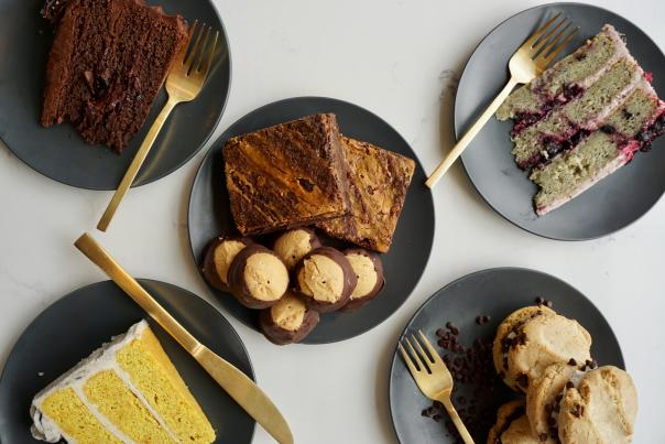 Five plates with assorted vegan desserts