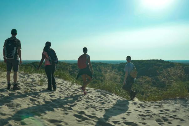 Hiking a trail in the PJ Hoffmaster State Park, which leads to a beach on Lake Michigan.