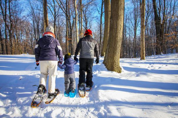 Family snowshoeing together