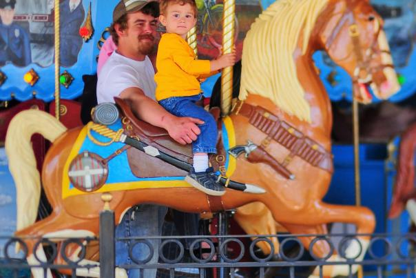 Dad & Son Riding the Carousel at Saginaw Children's Zoo