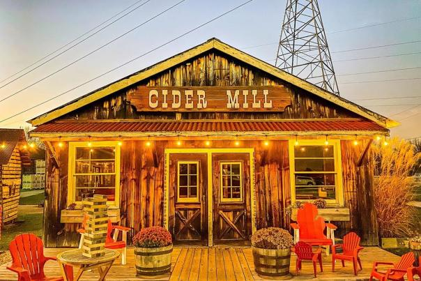 UGC - Things to Do - Farms + Orchards - Bayne's Apple Valley Farm - Cider Mill Illuminated at Sunset - @adamkostus