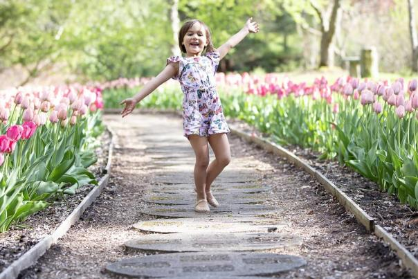 UGC - Things to Do - Family Fun - Dow Gardens - Little Girl Running Barefoot on Tulip-Lined Path - @em.stop