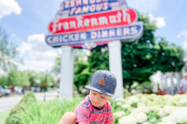 UGC - Eat + Drink - Restaurants - Zehnder's of Frankenmuth - Boy in Front of Sign on Summery Day - @mrstarabryant