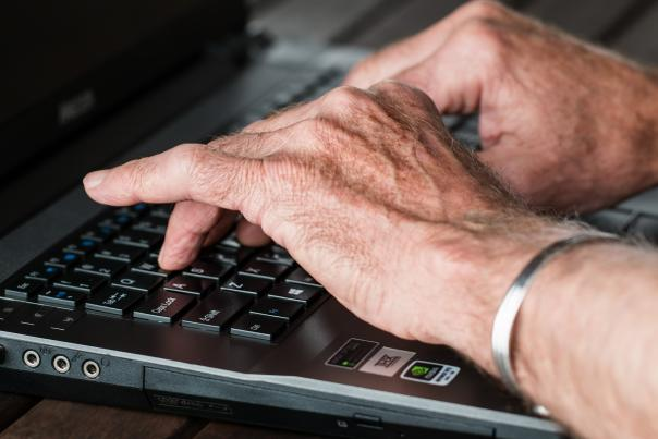 Stock: Senior older person on computer