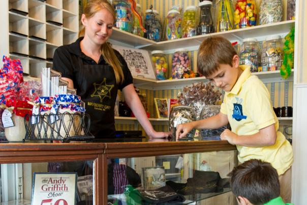 Mayberry Cafe children at front desk picking out prizes