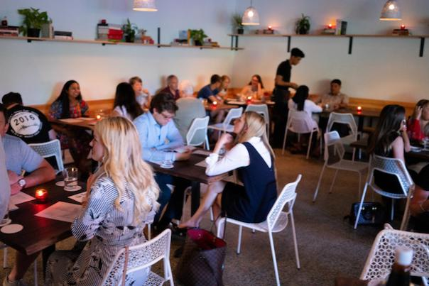 People dining at Night Heron in Houston's Montrose neighborhood