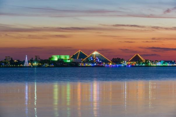 View of Moody Gardens with Christmas lights across the water near Houston