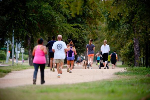 People Walking In Memorial Park In Houston, TX