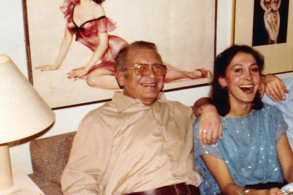 Jack Fixa sitting with Nina Khan with Ava artwork on wall behind them.