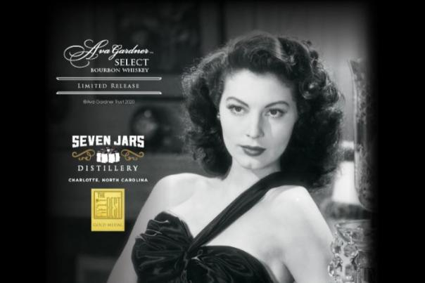 Ava Gardner in a scene from the Killers, wearing a one strap black dress. Text on the image gives details about the Ava Gardner Select Whiskey Bourbon from Seven Jars Distillery and an image of an award the whiskey won.