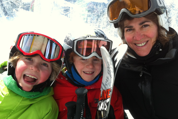 A family riding the chairlift