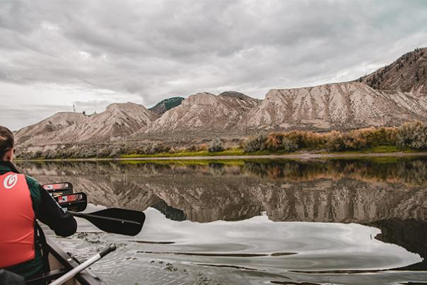 A canoe paddling down the river.