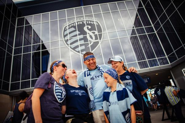 Family standing outside of Children's Mercy Park waiting for a Sporting KC game