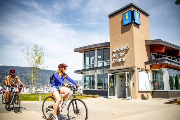 Biking by the Kelowna Visitor Centre