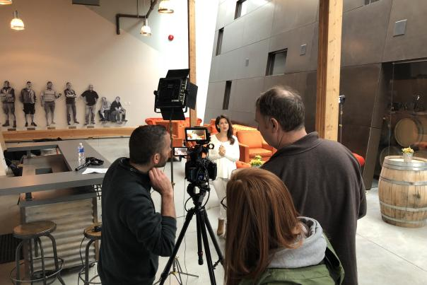 Behind the scenes photo of Jillian Harris filming with Tourism Kelowna