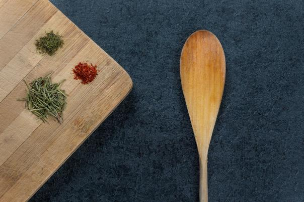 Wood Spoon and Cutting board with herbs