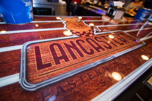A high-gloss finish makes this table shine at Lancaster's BBQ in Huntersville.