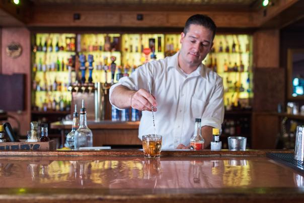 Bartender making Old Fashioned.