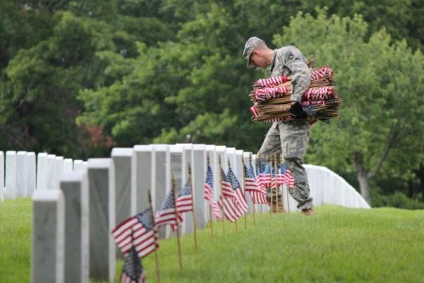 Soldier Placing Flags