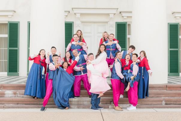 Wedding party having fun on the steps of Morven Park's Davis Mansion