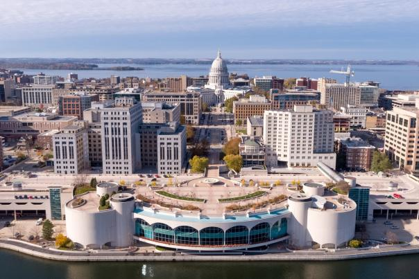 An aerial view of Monona Terrace and the State Capitol from Lake Monona