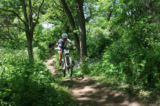 A mountain biker heads down a trail at CamRock Park
