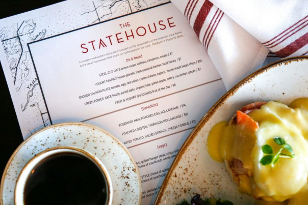 Coffee, eggs benedict and a menu from The Statehouse in Madison