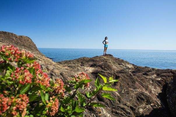 A woman posing on Black Rocks at Presque Isle Park