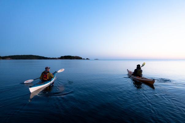 Kayakers paddling near Presque Isle at sunrise