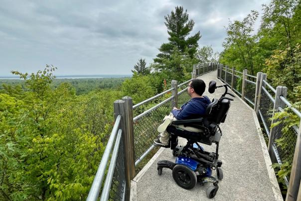 Cory Lee looking out at Thomas Rock Scenic Overlook on the ADA accessible trail