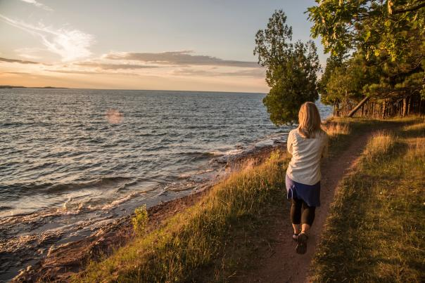 Sunset hike along Lake Superior at Presque Isle Park, Marquette, Michigan.
