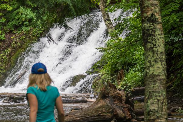 Exploring Morgan Falls on Morgan Creek in Marquette, Michigan.