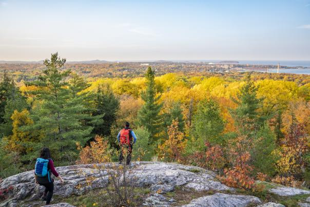 A couple hiking Mt. Marquette in autumn