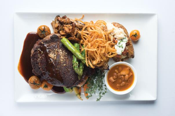 Coyote Cantina's Classic Cowboy Steak with Red Chile Onion Rings