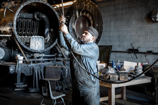 Mechanic Max Casias at work in the Cumbres & Toltec Scenic Railroad's Antonito depot