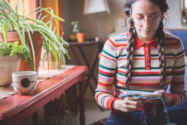 Christine Hernandez, aka Lil' Weavy , embroiders at Dandelion Guild