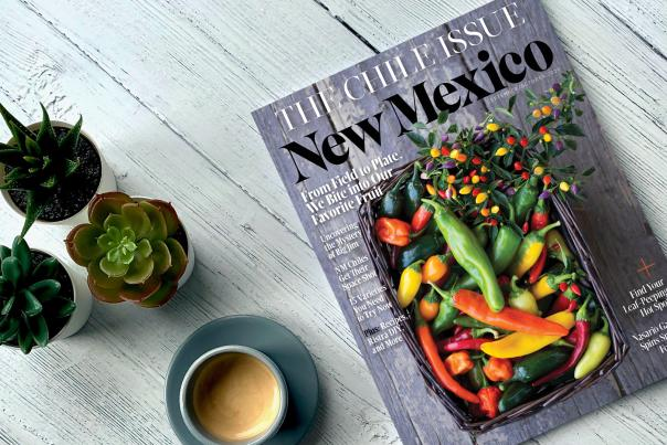 An image of the September/October issue of New Mexico Magazine with a cup of coffee and three succulents