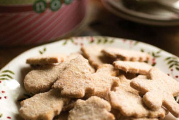 Plate of Christmas tree-shaped biscochito cookies