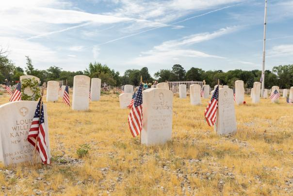 American flags mark the graves of veterans, whose collective service begins with the Civil War and runs through the Korean War at Fairview Memorial Park